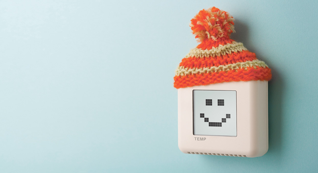 Digital regelbares Thermostat mit einem Gesicht und einer Mütze